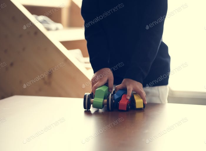 Japanese boy playing with his toy