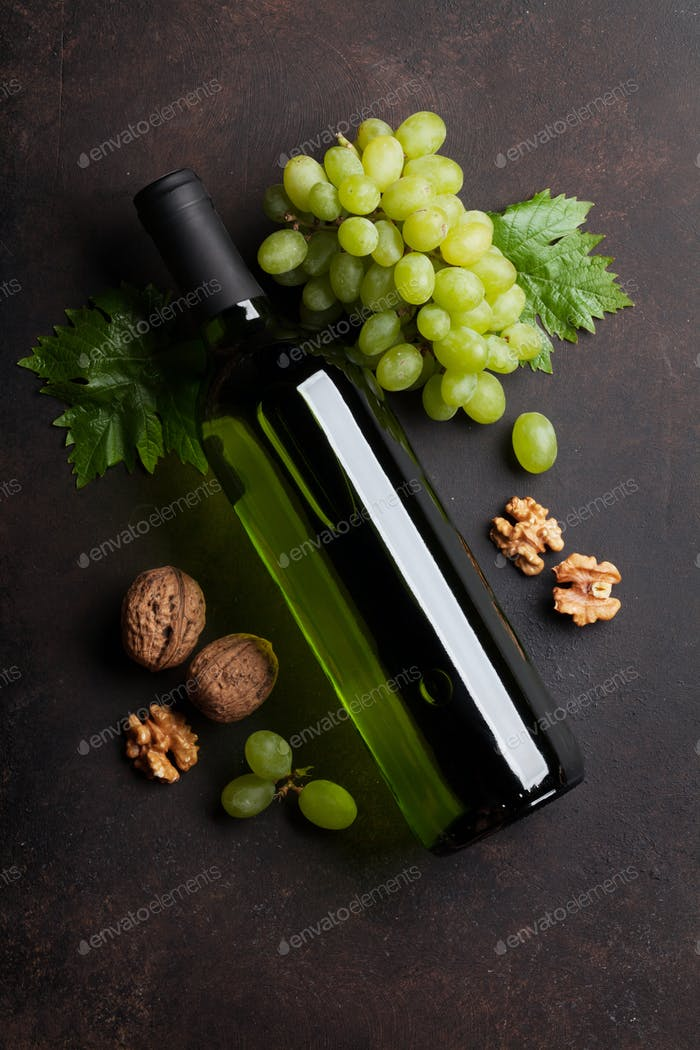 Wine bottle, grape and nuts