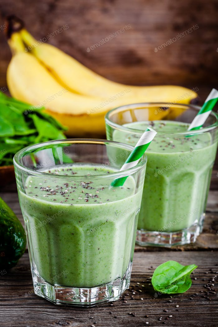 healthy green smoothie with banana, avocado, spinach and chia seeds  in glass
