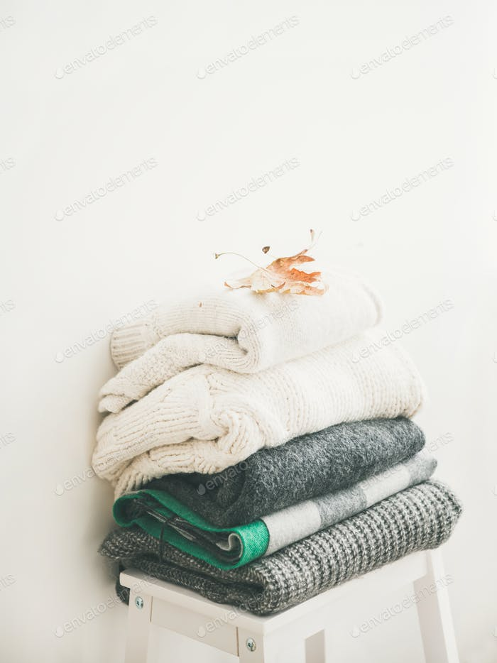 Pile of warm winter sweaters and blankets