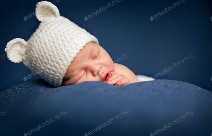 Three week old newborn baby boy sleeping