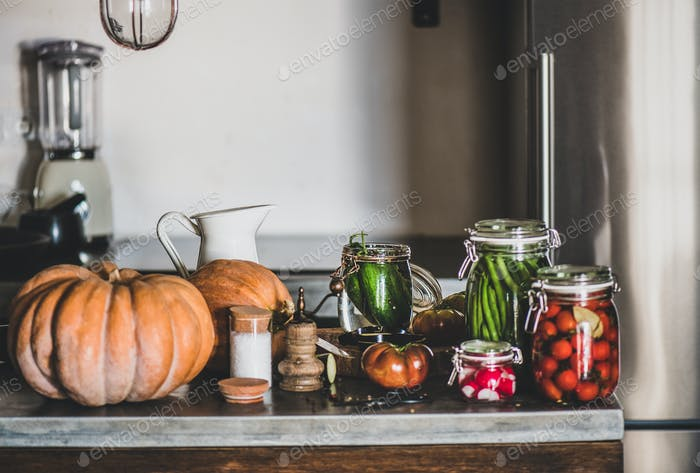 Ingredients for cooking and glass jars with homemade vegetables preserves
