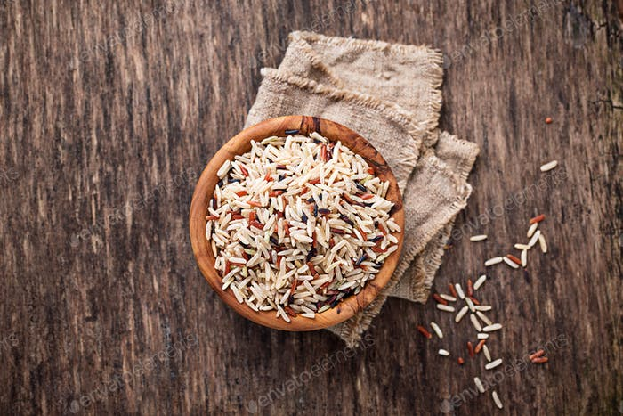 Mix of brown, red and wild rice in bowl