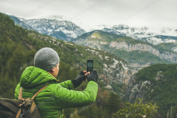 Young man traveller making photo of mountains, Alanya, Turkey