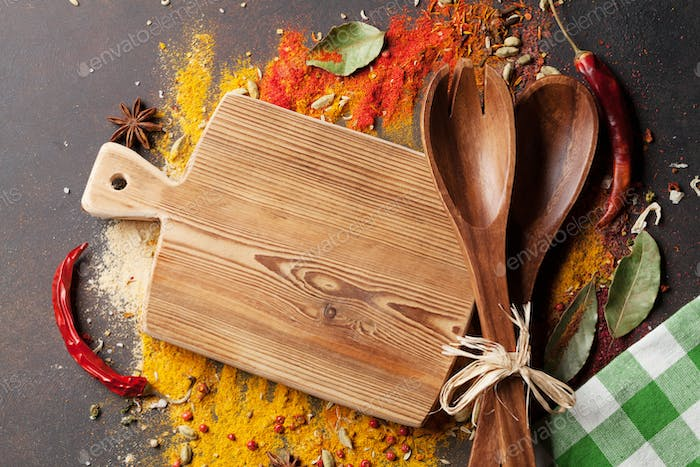 Various spices spoons and cutting board