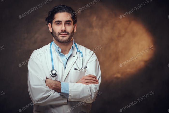 Portrait of smart handsome doctor over dark background.