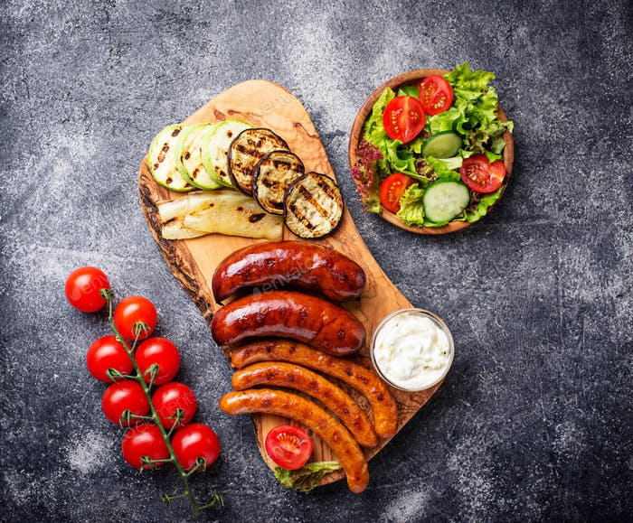 Assortment of grilled sausages and vegetables