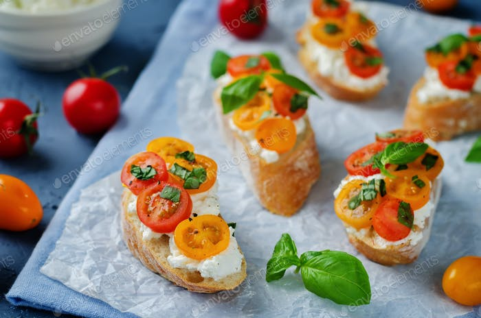 Ricotta tomato Basil bruschetta with fresh tomatoes and Basil le
