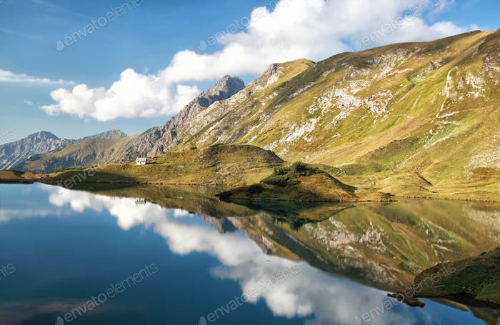 sky reflected in alpine lake
