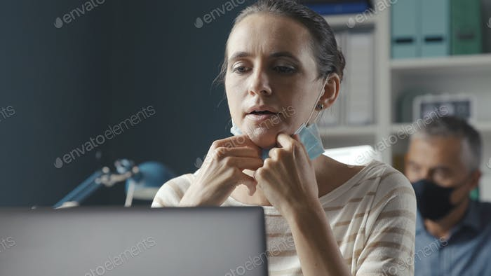 Woman having difficulties breathing with face mask