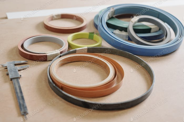 Rolled multi-color working materials for furniture production and calipers