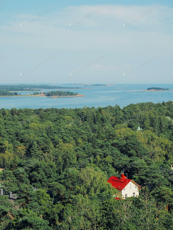 Shot of finnish archipelago and a red house