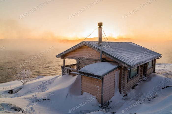 Wooden house on the beach in winter