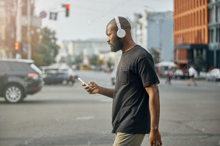 Urban life of one person walking alone and listening to music