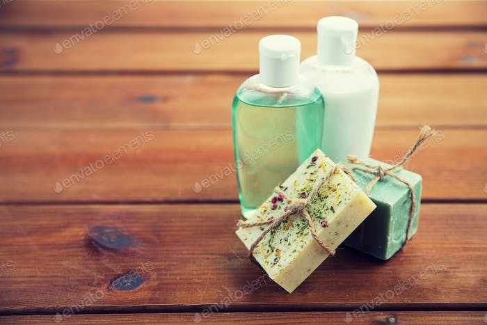 close up of handmade soap bars and lotions on wood
