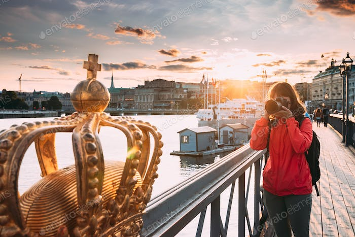 Stockholm, Sweden. Young Caucasian Woman Lady Tourist Traveler Photographer Taking Pictures Photos