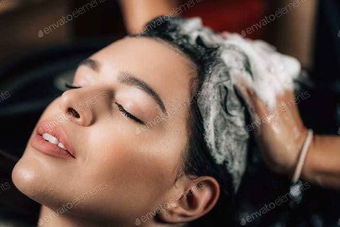 Hairstylist Applying Shampoo on Woman's Hair