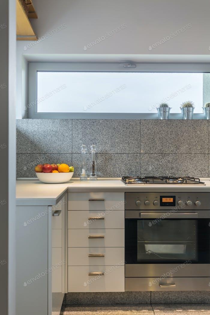 Granite tiles interior in simple kitchen