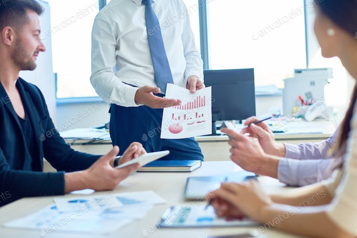 Businessman Presenting Strategy Plan in Meeting