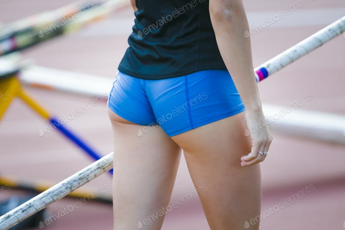 Female athlete competing in pole vault