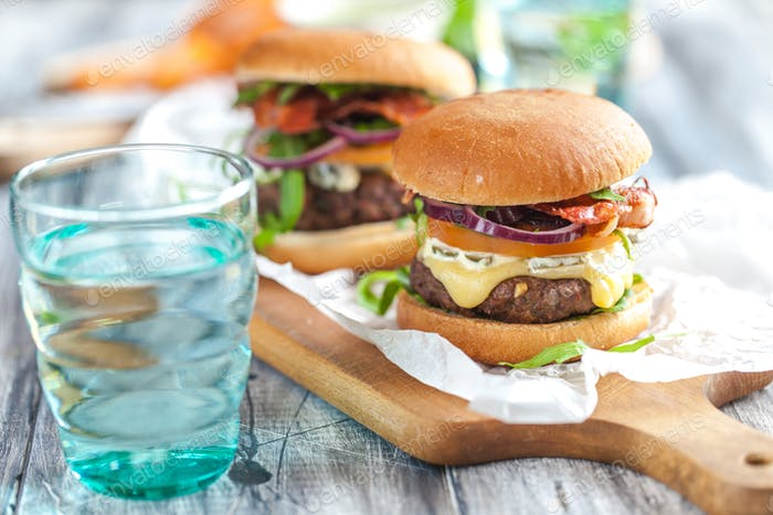 Homemade tasty burgers with cheese and pesto