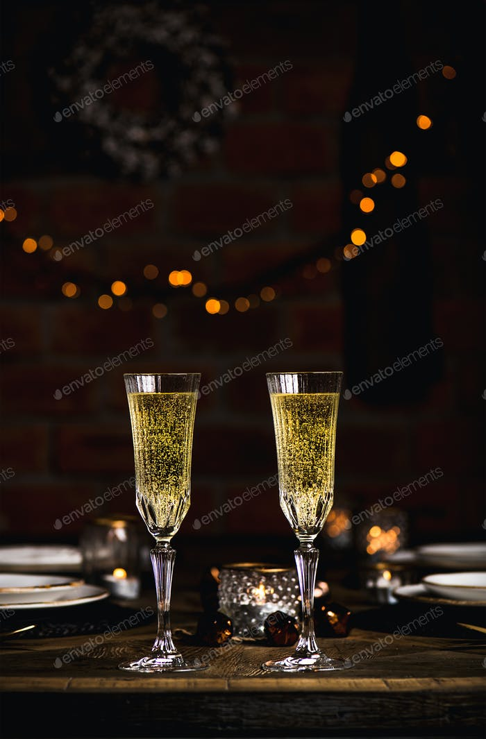 Christmas or New year celebration table set with champagne