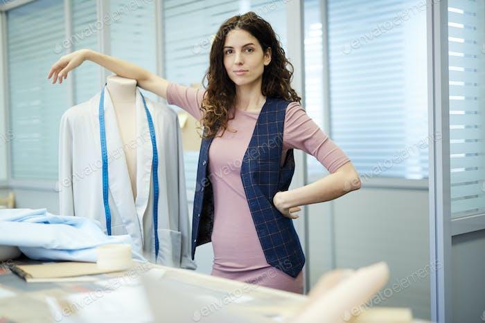 Confident female tailor in atelier