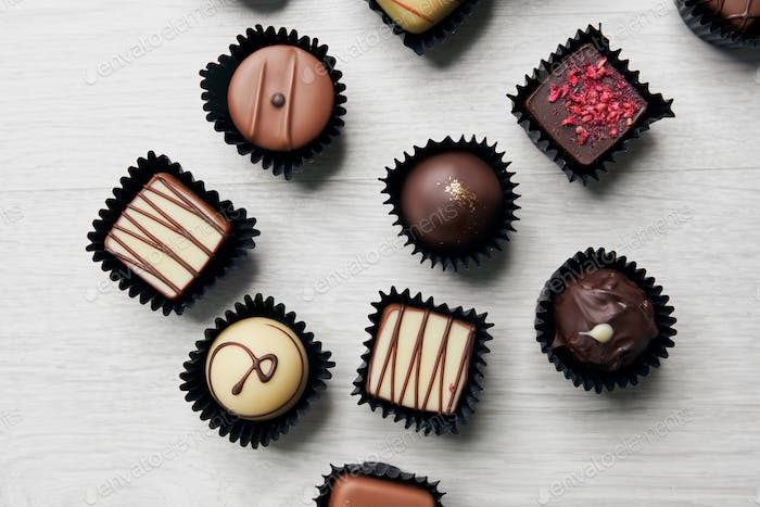 Assorted chocolate candies on table
