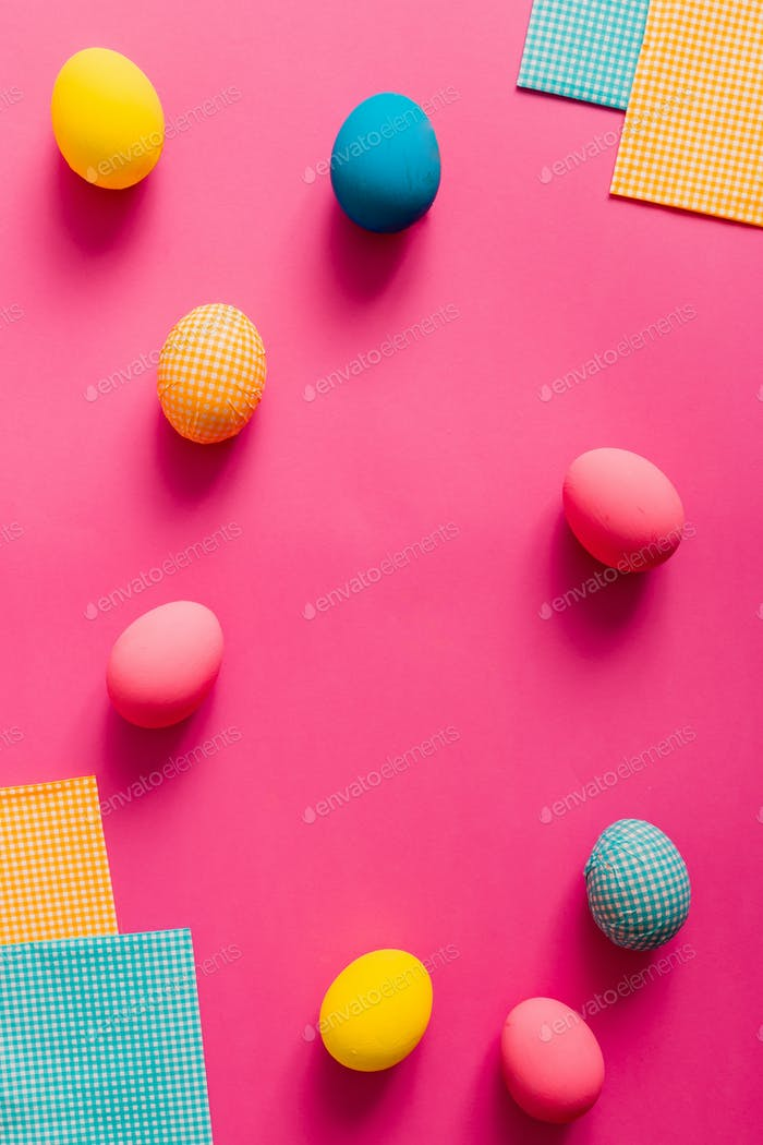 Easter eggs on pink paper