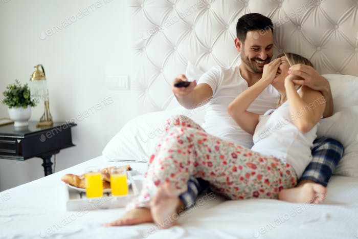 Couple relaxing in pajamas