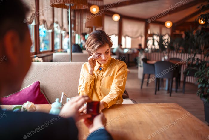 Marriage proposal with wedding ring at restaurant