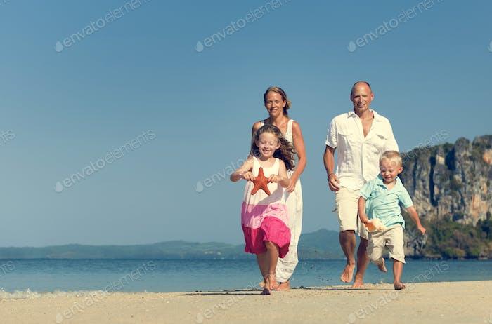 Family Father Mother Son Daughter Beach Fun Concept