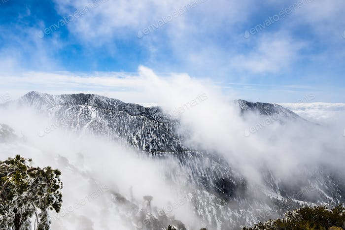 Changing weather with fog rising up from the valley, Mount San Antonio (Mt Baldy), south California