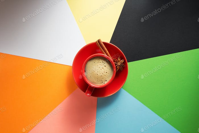 cup of coffee at colorful paper