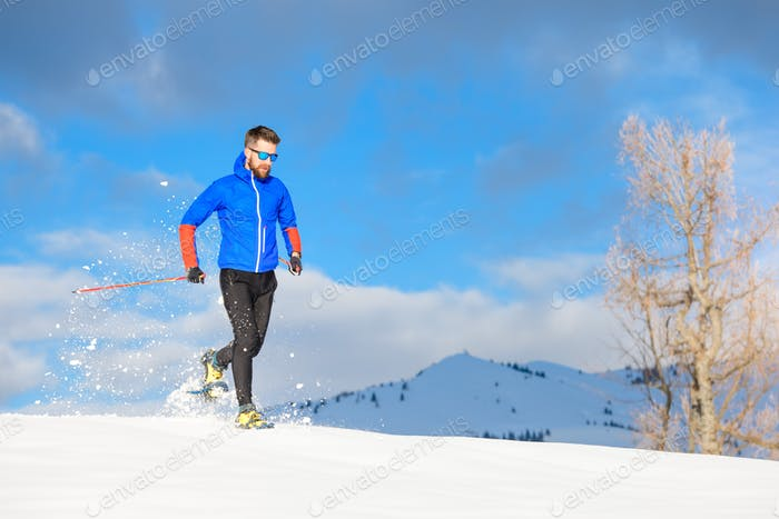 Runner with snowshoes