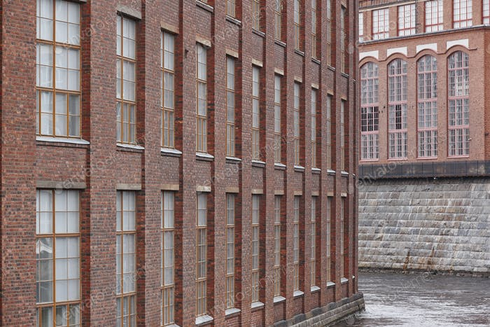 Old red brick facade factory buildings in Tampere, Finland. Suomi