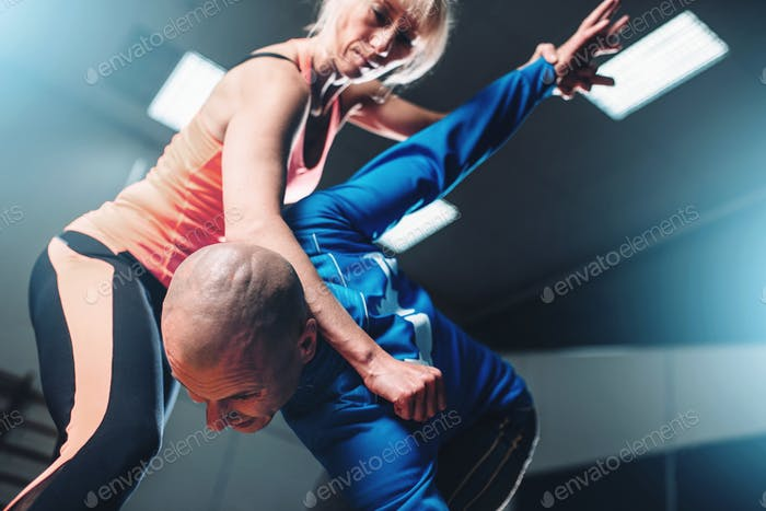 Male and female fighters, self-defense technique