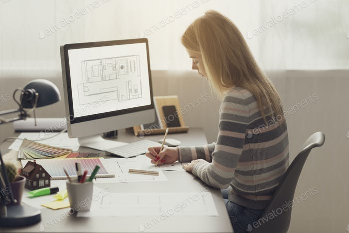 Professional interior designer working in the office