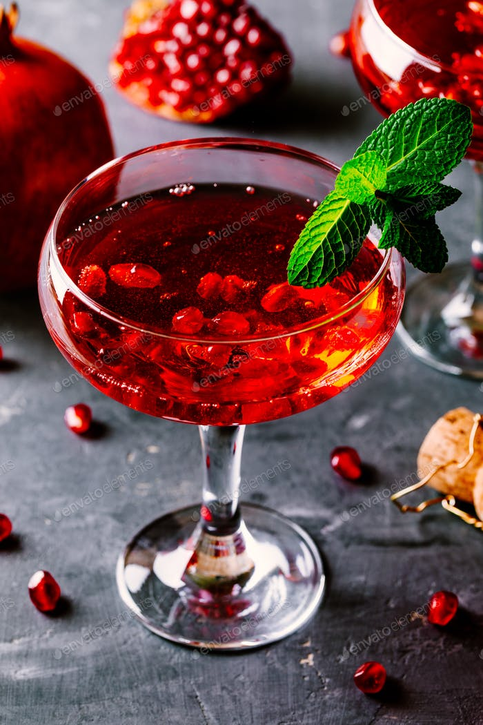 red cocktail with champagne and pomegranate seeds