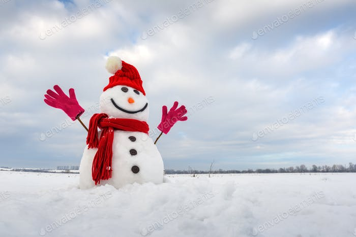 Funny snowman in stylish red hat and red scalf