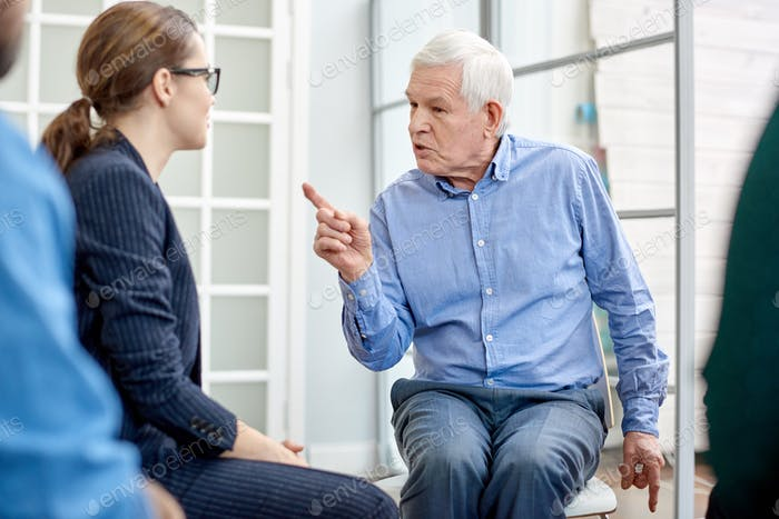 Senior Patient Communicating with Psychologist