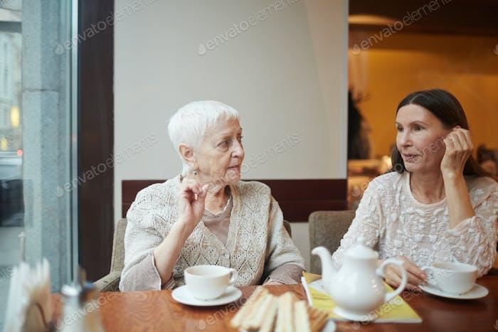 Women in armchairs