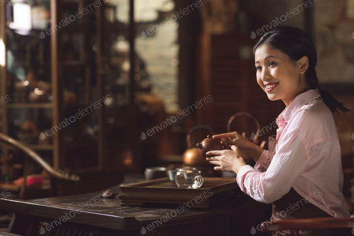 Young asian girl at tea ceremony