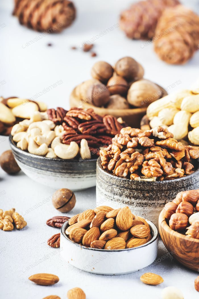 Assortment of nuts in bowls. Cashews, hazelnuts, walnuts, pistachios, pecans