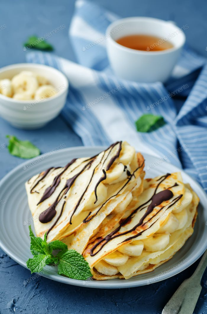 Crepes with fresh banana slaces and dark chocolate