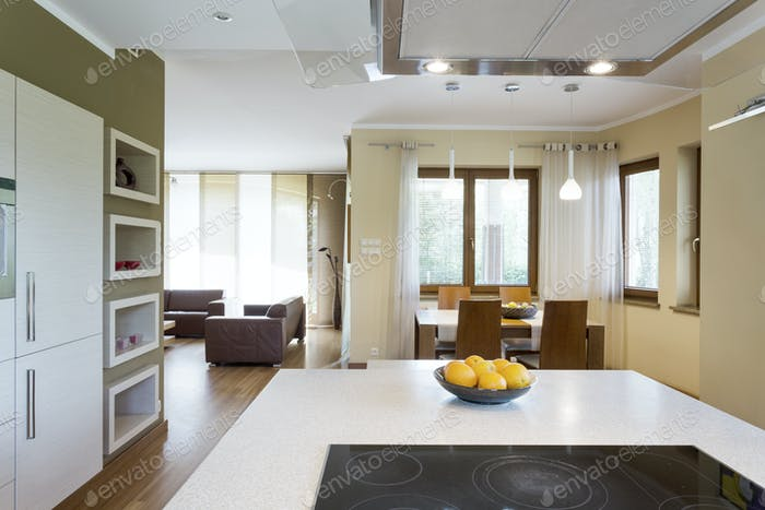 White kitchen island with electric cooktop