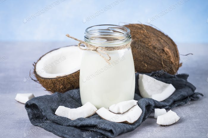 Coconut milk in glass jar. Vegan non dairy milk