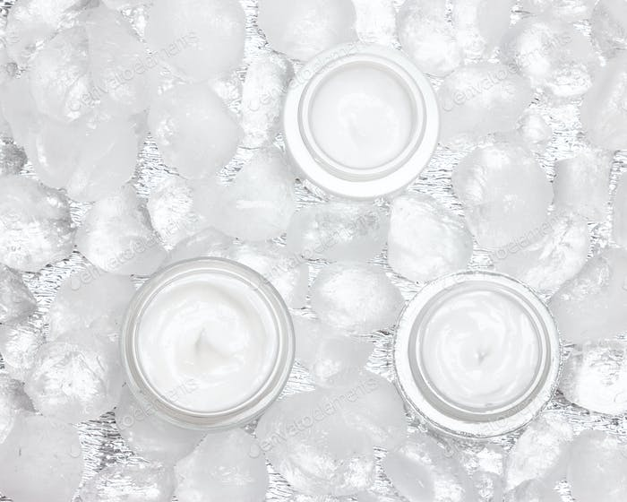 Cooling effect moisturizing creams surrounded by ice cubes