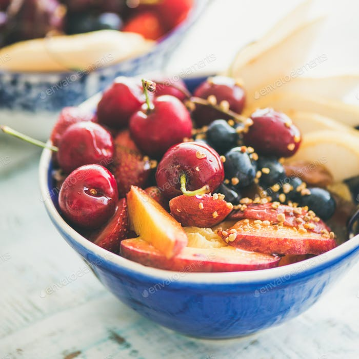 Healthy smoothie bowl with fruit and berries, square crop