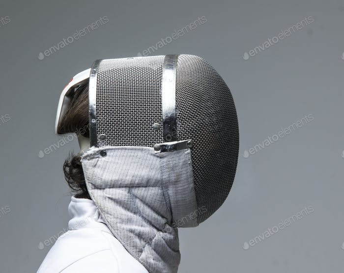 Profile of a fencer in fencing mask
